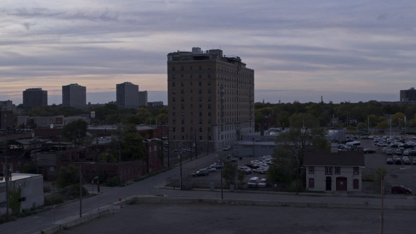 5.7K stock footage aerial video of orbiting an apartment building at sunset, Detroit, Michigan Aerial Stock Footage | DX0002_197_017