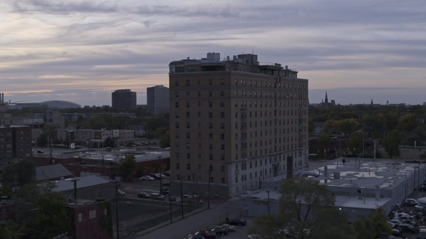 5.7K stock footage aerial video of slowly orbiting an apartment building at sunset, Detroit, Michigan Aerial Stock Footage | DX0002_197_018