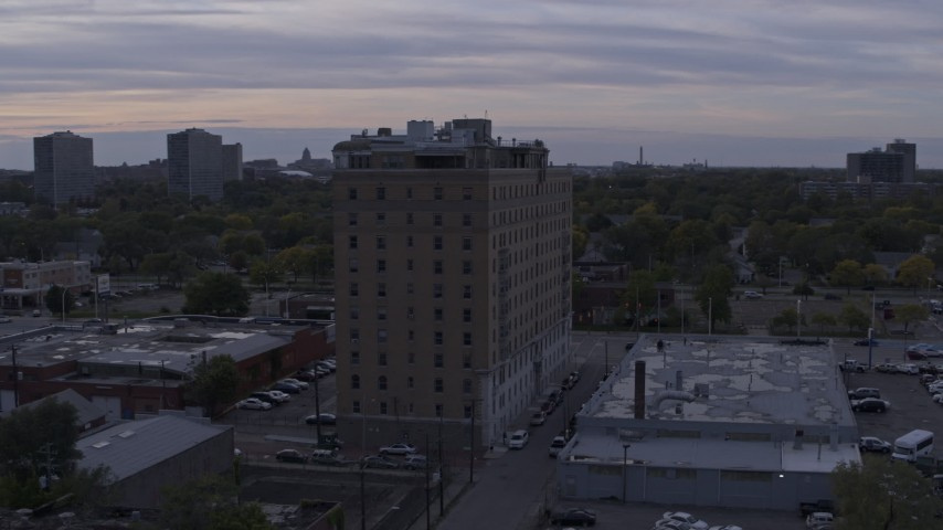 5.7K stock footage aerial video of circling an apartment building at sunset, Detroit, Michigan Aerial Stock Footage | DX0002_197_020