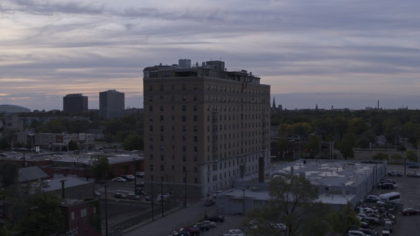 5.7K stock footage aerial video of ascending by an apartment building at sunset, Detroit, Michigan Aerial Stock Footage | DX0002_197_022