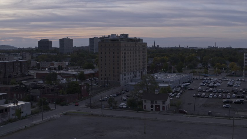 5.7K stock footage aerial video focus on an apartment building during descent at sunset, Detroit, Michigan Aerial Stock Footage | DX0002_197_024
