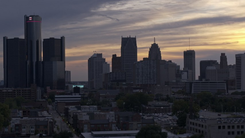 5.7K stock footage aerial video of flying by the city's skyline at sunset, Downtown Detroit, Michigan Aerial Stock Footage | DX0002_197_026