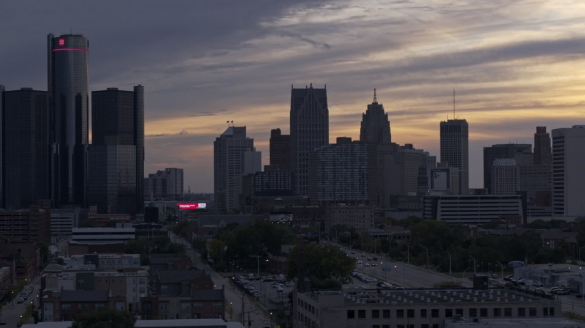 5.7K stock footage aerial video flyby top of building to reveal the city's skyline at sunset, Downtown Detroit, Michigan Aerial Stock Footage | DX0002_197_027