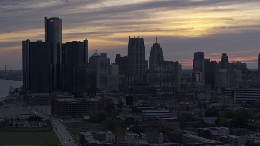 5.7K stock footage aerial video of flying by GM Renaissance Center and the city's skyline at sunset, Downtown Detroit, Michigan Aerial Stock Footage | DX0002_197_029