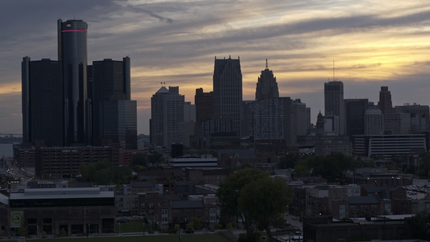 5.7K stock footage aerial video focus on GM Renaissance Center and the city's skyline at sunset during descent, Downtown Detroit, Michigan Aerial Stock Footage | DX0002_197_030