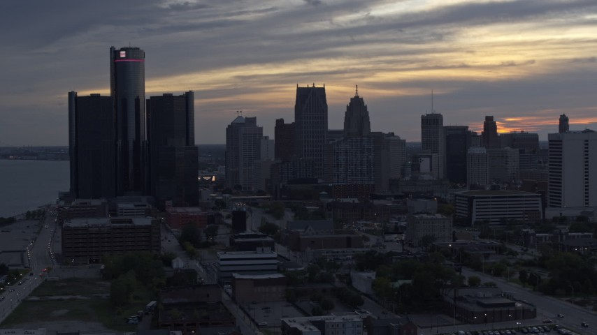 5.7K stock footage aerial video reverse view of GM Renaissance Center and the city's skyline at sunset, Downtown Detroit, Michigan Aerial Stock Footage | DX0002_197_032