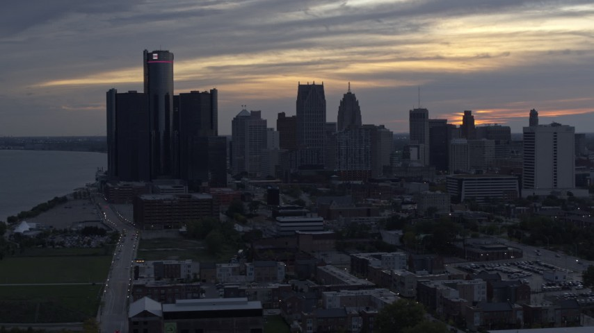 5.7K stock footage aerial video of passing by GM Renaissance Center and the city's skyline at sunset, Downtown Detroit, Michigan Aerial Stock Footage | DX0002_197_033