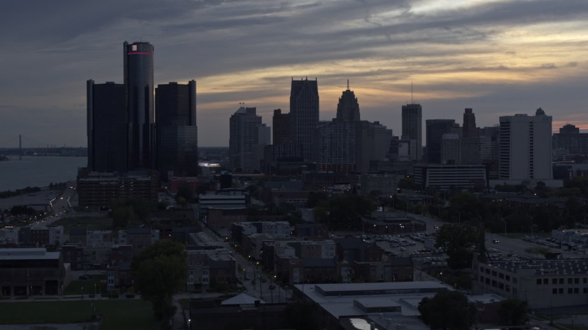 5.7K stock footage aerial video of a view of GM Renaissance Center and the skyline at sunset, Downtown Detroit, Michigan Aerial Stock Footage | DX0002_197_036