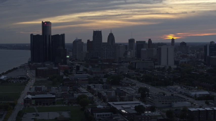 5.7K stock footage aerial video slowly passing GM Renaissance Center and the skyline at sunset, Downtown Detroit, Michigan Aerial Stock Footage | DX0002_197_039
