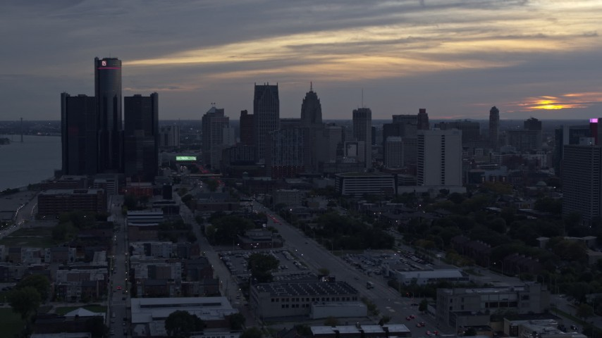 5.7K stock footage aerial video slowly flying past GM Renaissance Center and the skyline at sunset, Downtown Detroit, Michigan Aerial Stock Footage | DX0002_197_040