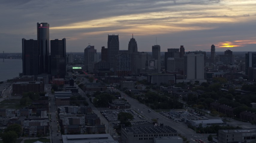 5.7K stock footage aerial video view of GM Renaissance Center and the skyline at sunset, Downtown Detroit, Michigan Aerial Stock Footage | DX0002_197_041