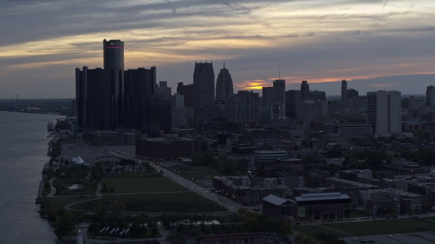 5.7K stock footage aerial video the riverfront GM Renaissance Center and skyline at sunset, Downtown Detroit, Michigan Aerial Stock Footage | DX0002_197_042