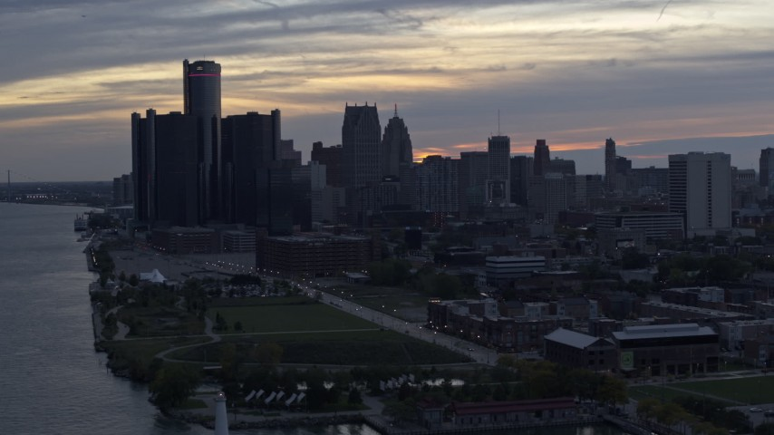 5.7K stock footage aerial video the riverfront GM Renaissance Center and skyscrapers at sunset, Downtown Detroit, Michigan Aerial Stock Footage | DX0002_197_043