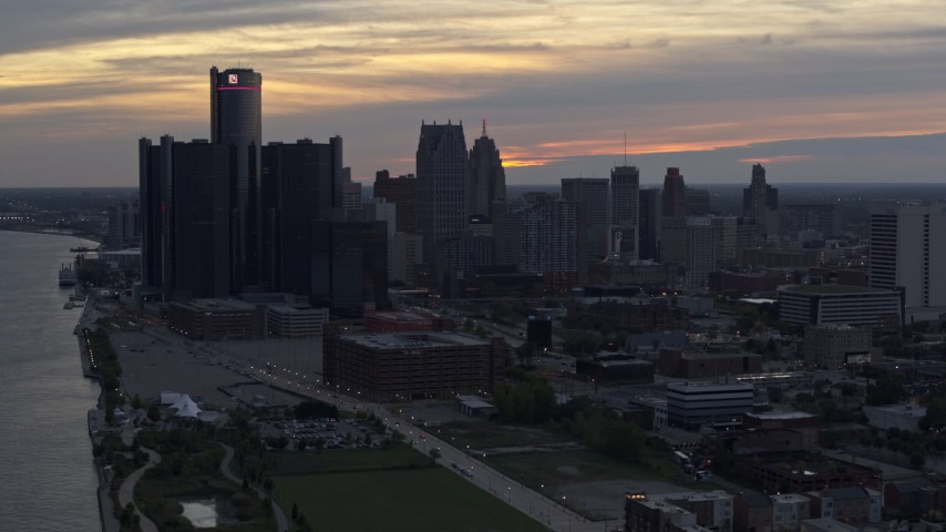 5.7K stock footage aerial video of the city's tall skyscrapers at sunset, Downtown Detroit, Michigan Aerial Stock Footage | DX0002_197_046