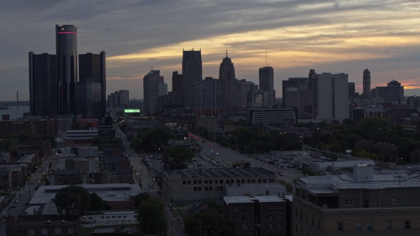 5.7K stock footage aerial video of flying by the city's tall skyscrapers at sunset, Downtown Detroit, Michigan Aerial Stock Footage | DX0002_197_048