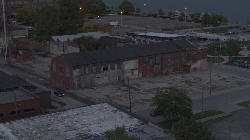 5.7K stock footage aerial video of orbiting an abandoned brick building at sunset, Detroit, Michigan Aerial Stock Footage | DX0002_197_049