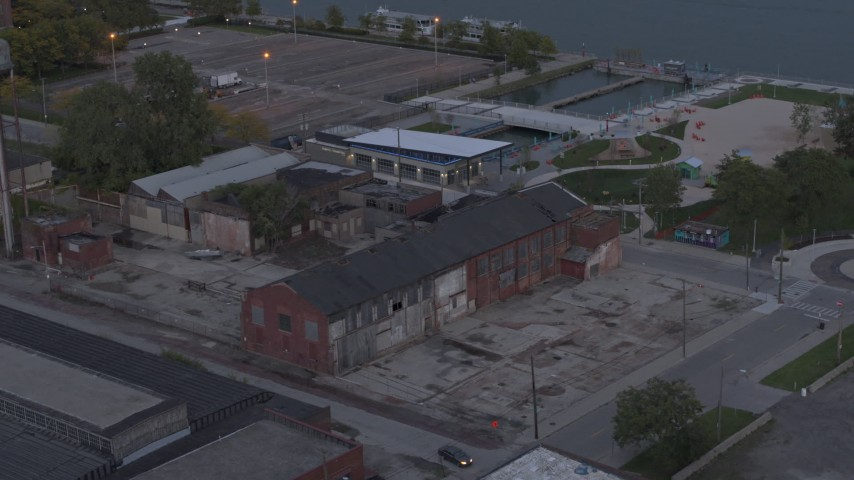 5.7K stock footage aerial video of circling above an abandoned brick building at sunset, Detroit, Michigan Aerial Stock Footage | DX0002_197_053