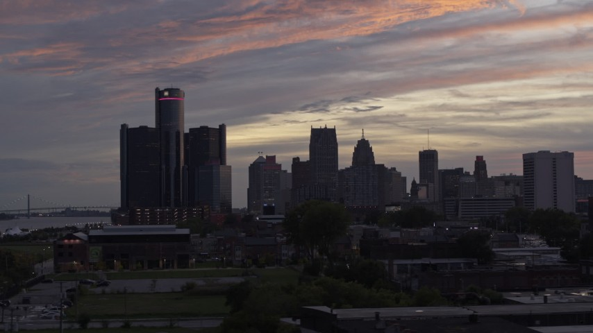 5.7K stock footage aerial video of flying low with a view of the city's towering skyscrapers at sunset, Downtown Detroit, Michigan Aerial Stock Footage | DX0002_198_001