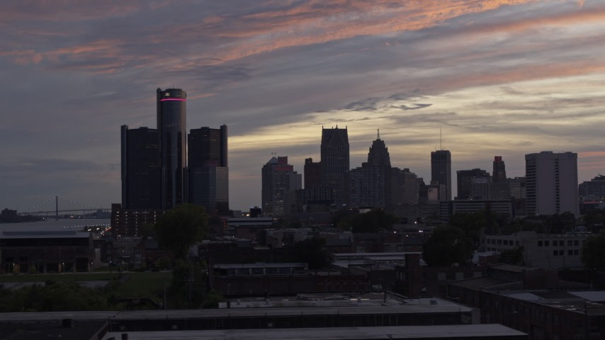 5.7K stock footage aerial video of flying low past the city's towering skyscrapers at sunset, Downtown Detroit, Michigan Aerial Stock Footage | DX0002_198_002