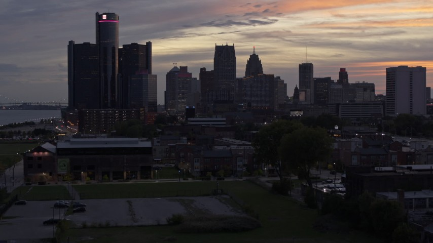5.7K stock footage aerial video of ascending toward the city's towering skyscrapers at sunset, Downtown Detroit, Michigan Aerial Stock Footage | DX0002_198_003