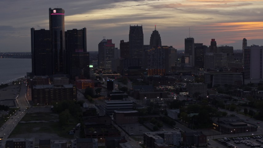 5.7K stock footage aerial video of slowly flying away from the city's towering skyscrapers at sunset, Downtown Detroit, Michigan Aerial Stock Footage | DX0002_198_004