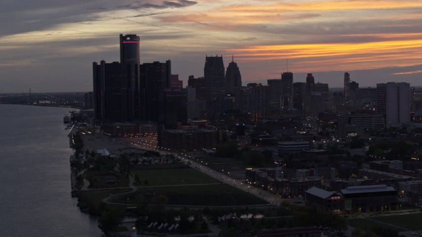 5.7K stock footage aerial video the city's towering skyscrapers at sunset seen from the river, Downtown Detroit, Michigan Aerial Stock Footage | DX0002_198_006