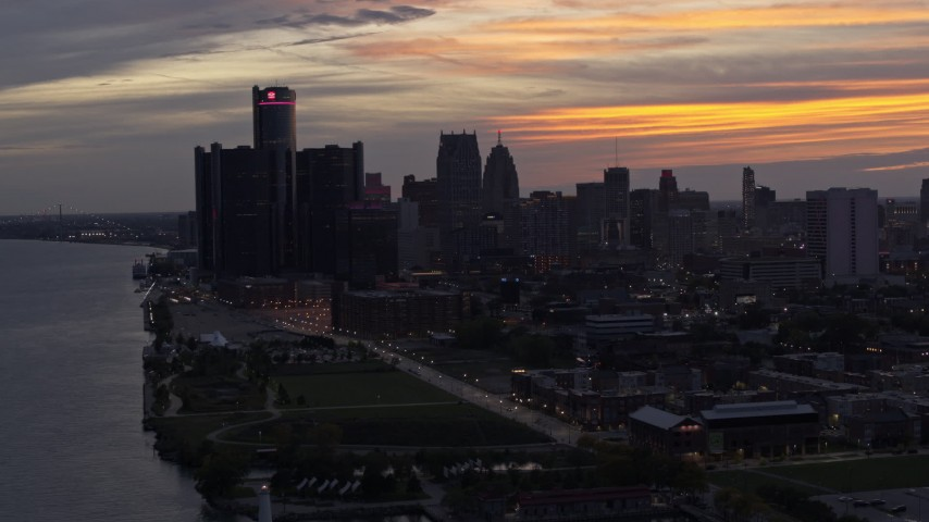 5.7K stock footage aerial video the city's towering skyscrapers at sunset seen from the Detroit River, Downtown Detroit, Michigan Aerial Stock Footage | DX0002_198_007