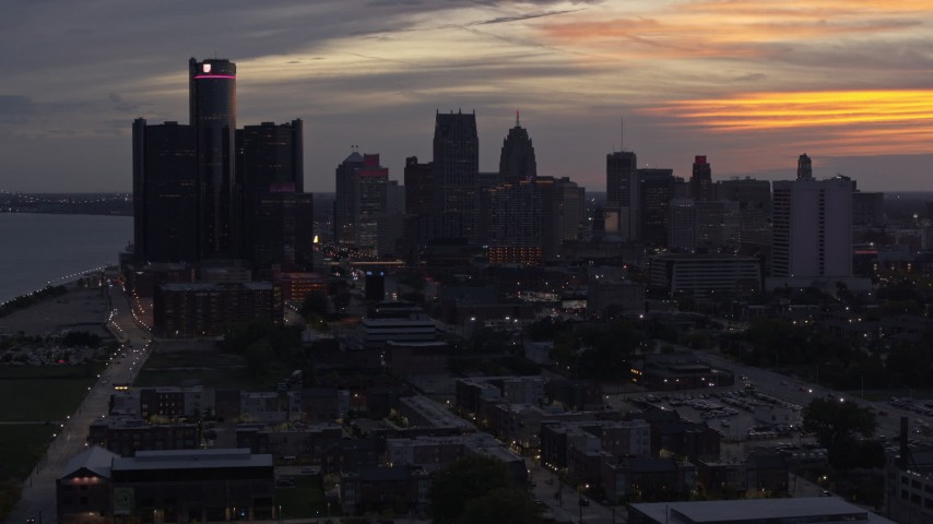 5.7K stock footage aerial video the city's towering skyscrapers at sunset seen during descent, Downtown Detroit, Michigan Aerial Stock Footage | DX0002_198_008