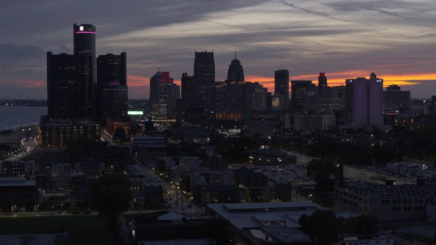 5.7K stock footage aerial video of flying by the city's towering skyscrapers at twilight, Downtown Detroit, Michigan Aerial Stock Footage | DX0002_198_009
