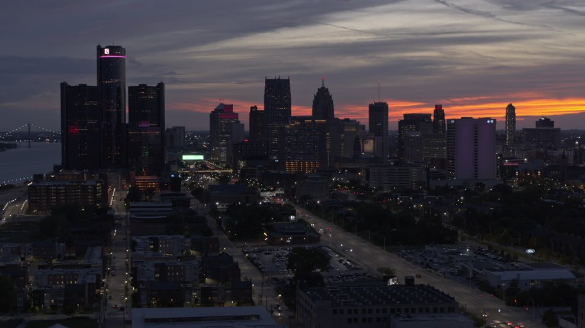 5.7K stock footage aerial video of ascending past the city's towering skyscrapers at twilight, Downtown Detroit, Michigan Aerial Stock Footage | DX0002_198_010