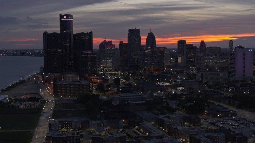 5.7K stock footage aerial video of slowly approach and flying by the city's towering skyscrapers at twilight, Downtown Detroit, Michigan Aerial Stock Footage | DX0002_198_011