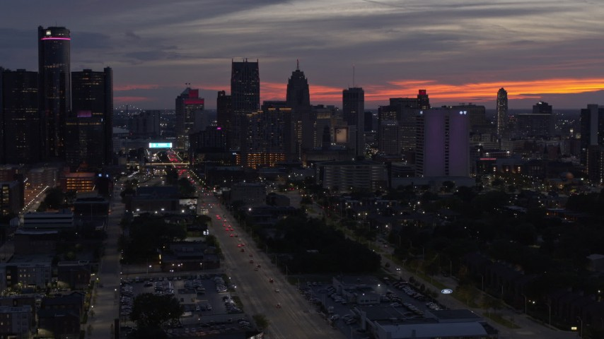 5.7K stock footage aerial video of slowly flying away from the city's towering skyscrapers at twilight, Downtown Detroit, Michigan Aerial Stock Footage | DX0002_198_012