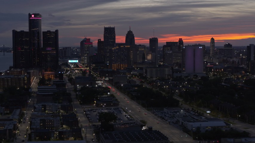 5.7K stock footage aerial video of slowly passing the city's towering skyscrapers at twilight, Downtown Detroit, Michigan Aerial Stock Footage | DX0002_198_013