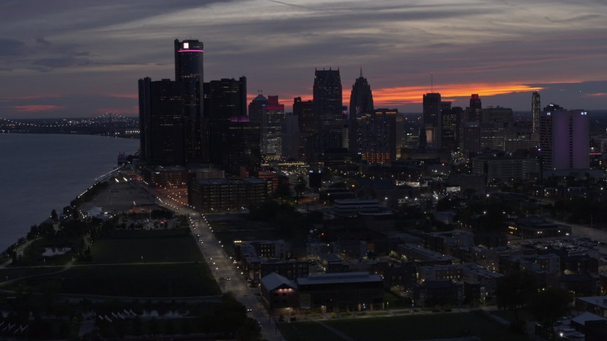 5.7K stock footage aerial video of flying past the city's tall skyscrapers at twilight, Downtown Detroit, Michigan Aerial Stock Footage | DX0002_198_014