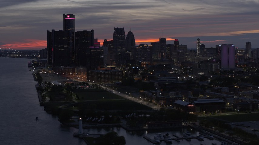 5.7K stock footage aerial video of the city's tall skyscrapers by the Detroit River at twilight, Downtown Detroit, Michigan Aerial Stock Footage | DX0002_198_015