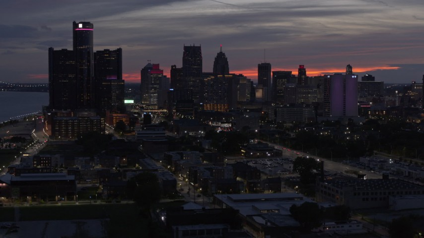 5.7K stock footage aerial video of flying by tall skyscrapers at twilight in Downtown Detroit, Michigan Aerial Stock Footage | DX0002_198_016