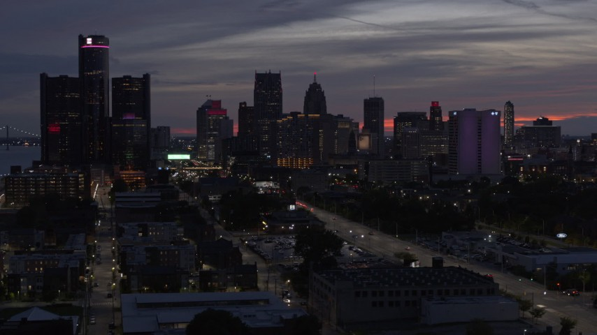 5.7K stock footage aerial video of slowly flying by tall skyscrapers at twilight in Downtown Detroit, Michigan Aerial Stock Footage | DX0002_198_017