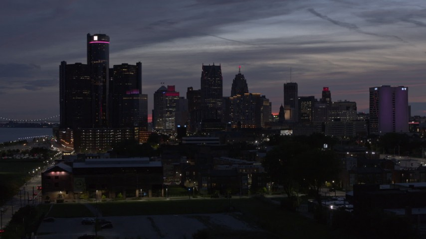 5.7K stock footage aerial video ascend and approach tall skyscrapers at twilight in Downtown Detroit, Michigan Aerial Stock Footage | DX0002_198_018