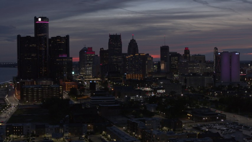 5.7K stock footage aerial video flying by giant skyscrapers at twilight in Downtown Detroit, Michigan Aerial Stock Footage | DX0002_198_019