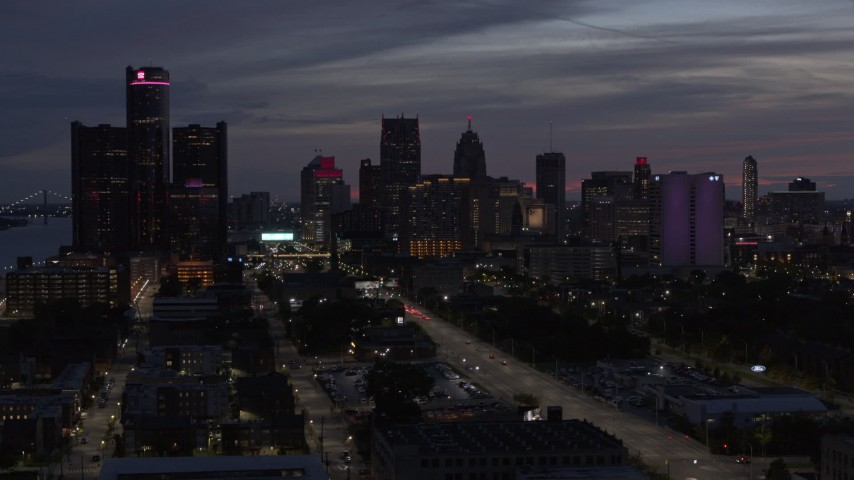 5.7K stock footage aerial video passing by giant skyscrapers at twilight in Downtown Detroit, Michigan Aerial Stock Footage | DX0002_198_020