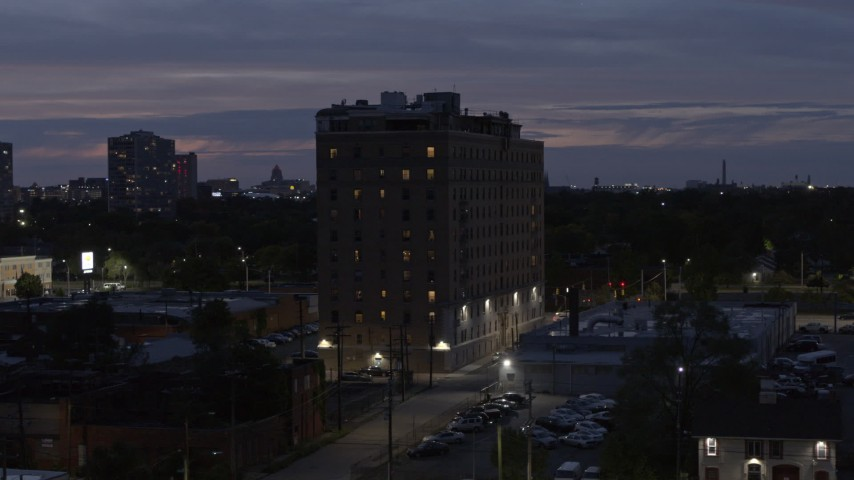 5.7K stock footage aerial video of orbiting an apartment building at twilight, Detroit, Michigan Aerial Stock Footage | DX0002_198_021