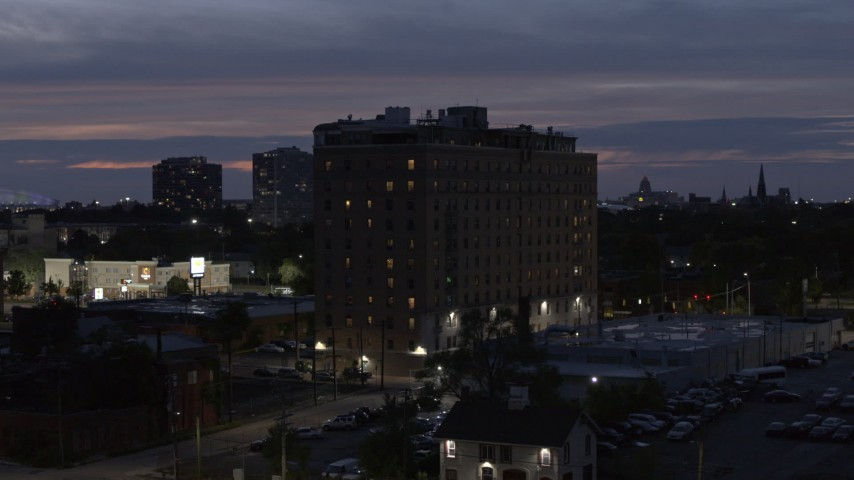5.7K stock footage aerial video of circling an apartment building at twilight, Detroit, Michigan Aerial Stock Footage | DX0002_198_023