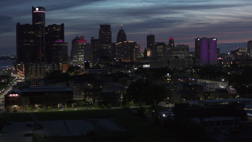 5.7K stock footage aerial video of ascending toward the city's skyline at twilight in Downtown Detroit, Michigan Aerial Stock Footage | DX0002_198_025