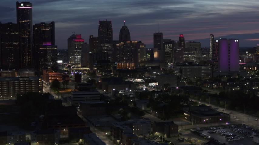 5.7K stock footage aerial video of flying by and away from the city's skyline at twilight in Downtown Detroit, Michigan Aerial Stock Footage | DX0002_198_026