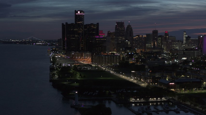 5.7K stock footage aerial video of the city's skyline, seen from the river at twilight in Downtown Detroit, Michigan Aerial Stock Footage | DX0002_198_029
