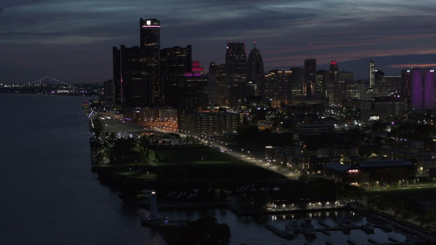 5.7K stock footage aerial video of the city's skyline, seen while flying over the river at twilight in Downtown Detroit, Michigan Aerial Stock Footage | DX0002_198_030