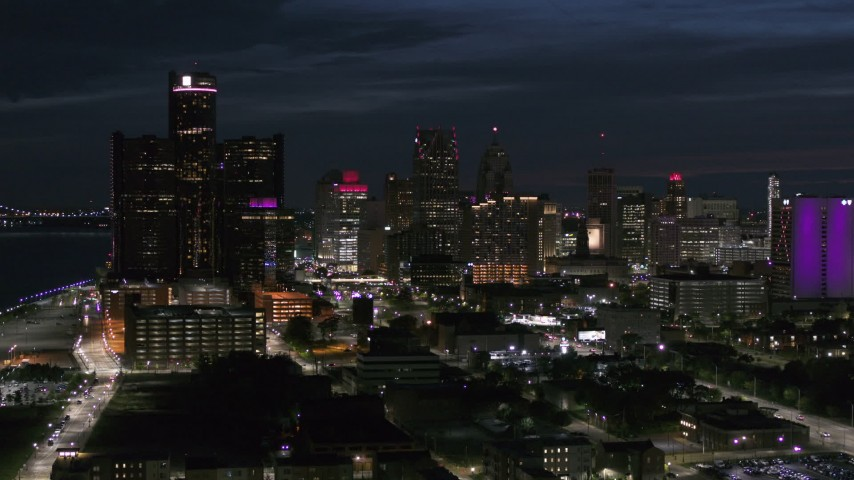 5.7K stock footage aerial video of ascending toward the brightly lit city skyline at twilight in Downtown Detroit, Michigan Aerial Stock Footage | DX0002_198_032