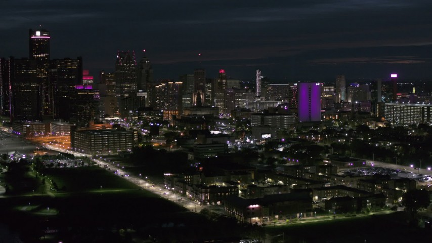 5.7K stock footage aerial video of a view of the brightly lit city skyline at night, Downtown Detroit, Michigan Aerial Stock Footage | DX0002_198_036