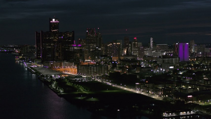 5.7K stock footage aerial video of the brightly lit skyscrapers in the city skyline at night, Downtown Detroit, Michigan Aerial Stock Footage | DX0002_198_037
