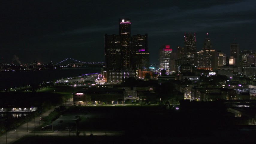 5.7K stock footage aerial video GM Renaissance Center while flying toward river at night, Downtown Detroit, Michigan Aerial Stock Footage | DX0002_198_042